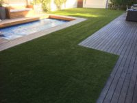 landscaping-with-synthetic-grass-around-wooden-decks